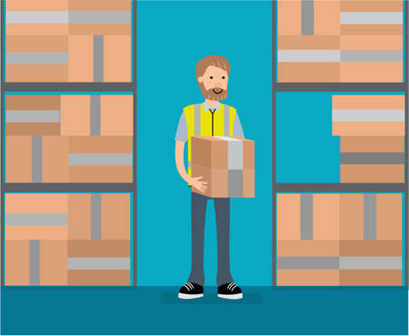 A warehouse worker in warehouse holding boxes.
