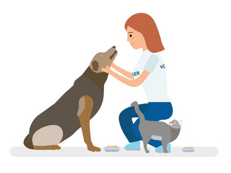 Young volunteer girl feeds homeless animals - dog and cat.