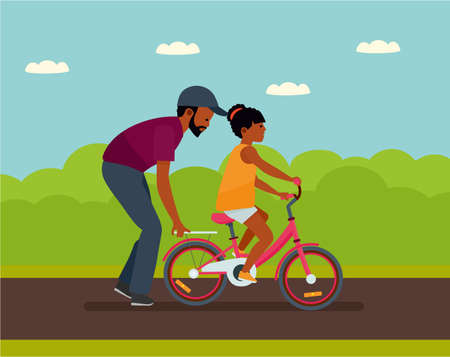 Family leisure on summer time for African-American people. Father walking with daughter in the park while helping daughter to ride a bike.