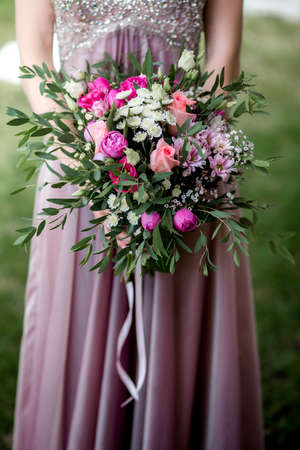 Bride in a dress with a wedding bouquet,