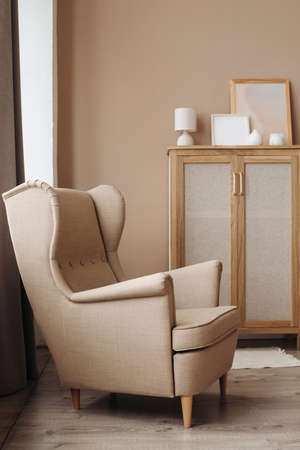 A luxurious cushioned window seat in a soft beige color in a light pastel interior.