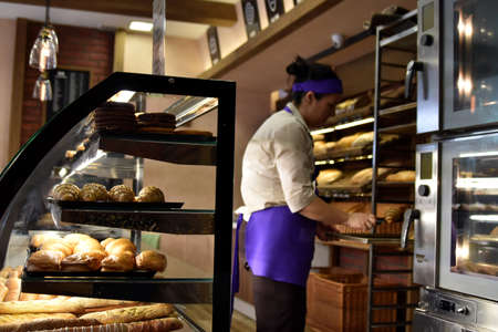 Bakery shop interior with female sale worker