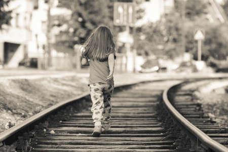 careless: Girl child running on railroad tracks