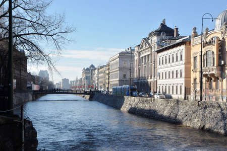 Scenery view of old city historical center with river and buildings