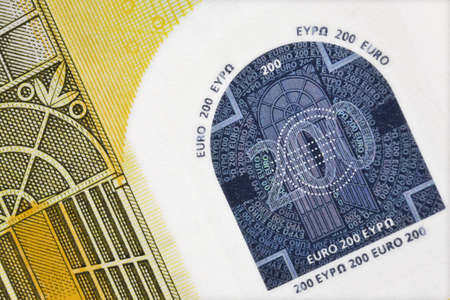 greatly: greatly enlarged detail of a 200 euro banknote