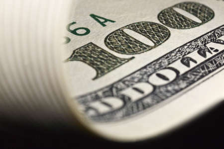 greatly: greatly enlarged detail of a $ 100 banknote