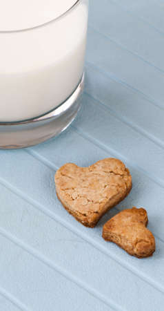 heart ginger cookies with glass of milk photo