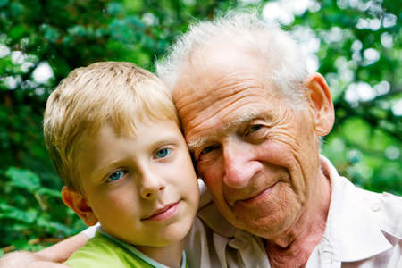 young boy - grandchild, and his grandfather - old man Stock Photo