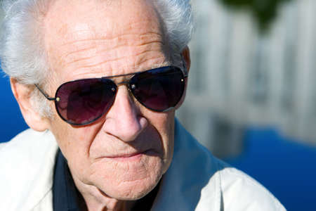 closeup portrait of a serious old senior in sunglasses Stock Photo - 5611192