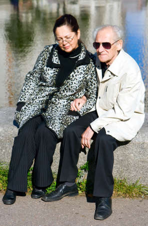 portrait of a family - old man in sunglasses and his wife
