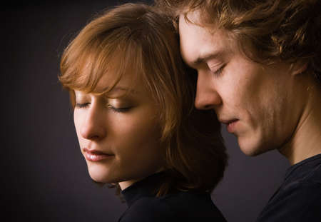 portrait of a loving couple with closed eyes in studio photo