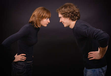 portrait of a couple: man and woman are looking at each other and putting their hands on their hips Stock Photo - 6409634
