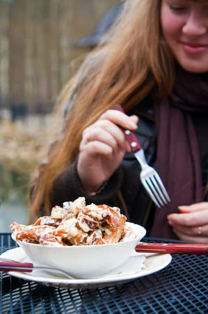 woman eating traditional snacks for beer - fried pieces of bread with cheese photo