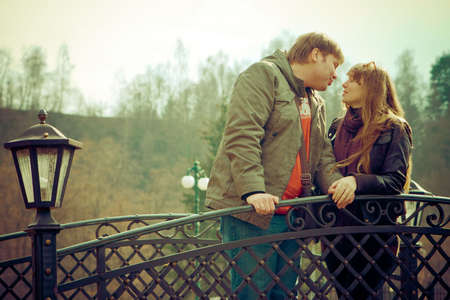 romantic couple standing on a bridge, they are going to kiss each other Stock Photo - 6931517