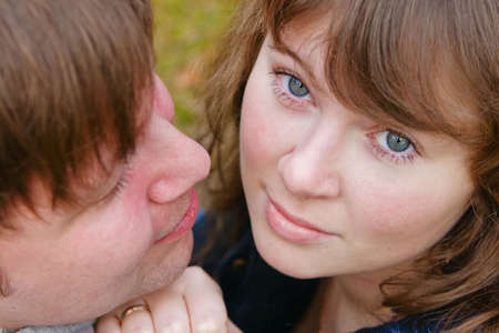 close-up portrait of a young beautiful wife and her husband, he is looking at her Stock Photo - 6931515