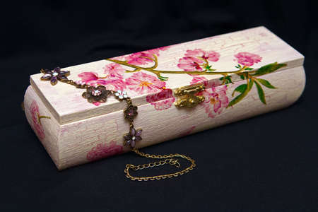pink decoupage box with painted flowers and a bijouterie photo