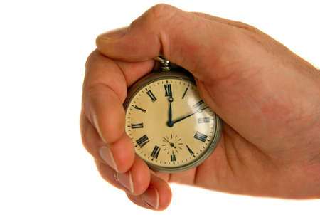 hand with old pocket watch, isolated on white background photo