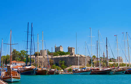 sailing yachts in Bodrum, we can also see an old castle Stock Photo
