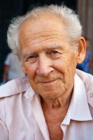face portrait of a smiling senior man