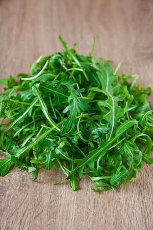 close-up heap of green ruccola on a table photo