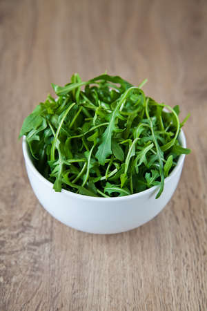 close-up heap of ruccola in a white bowl Stock Photo - 9113435