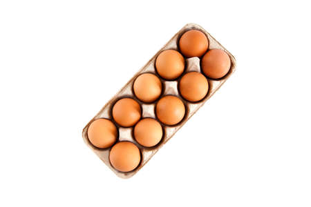 brown eggs in a carton, isolated on white background photo