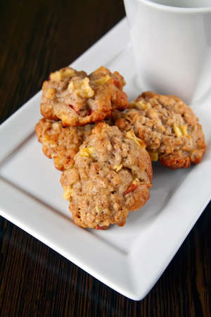 close-up homemade cookies with oatmeal, apple and cinnamon photo