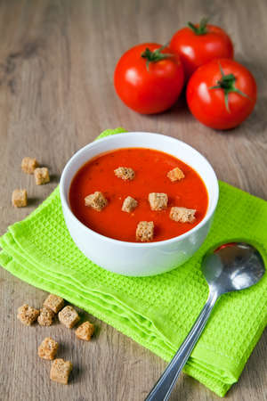 close-up tomatoes soup served with croutons photo