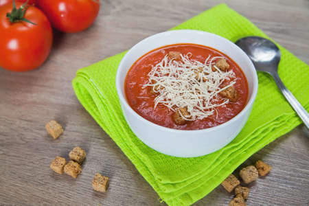 close-up tomatoes soup served with croutons and parmesan photo