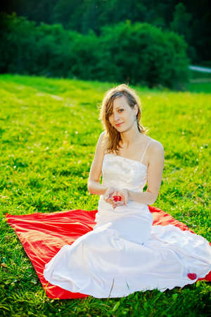 a bride holding in her hands red heart - symbol of love photo