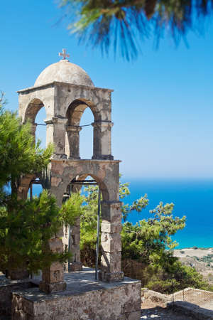 lonely campanile located in the far corner of Kos Island near historic Orthodox church Agios Ioannis photo