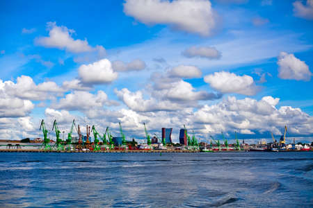 view of the Klaipeda harbour with ships and cranes, Lithuania Stockfoto