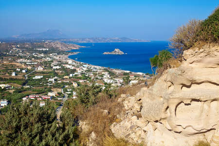 dodecanese: panorama of the Kamari bay with little island Kastri in the south part of the Kos in Greece, Dodecanese
