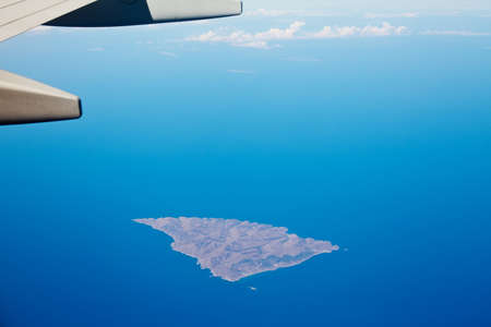 Boeing 737 wing flyingd above Greek island photo