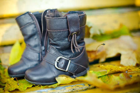 close-up pair of brown childrens boots for autumn photo