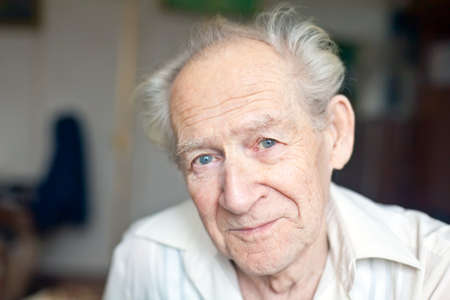 face portrait of a cheerful smiling senior man