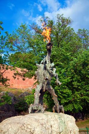 wawel: Wawel dragon throwing up fire, it is located in a cave under Wawel Hill in Krakow, Poland