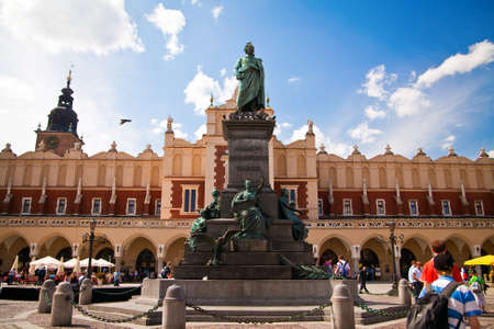 national poet: Adam Mickiewicz monument in front of Sukiennice on the Krakow main square, Poland