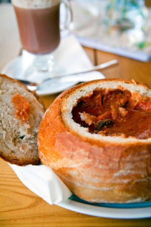 Traditional hungarian and polish soup - goulash served in a bread bowl