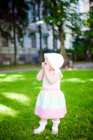 little girl staring in amazement at soup bubbles photo
