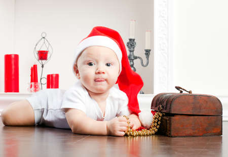 close-up portrait of a little lying boy in christmas cap