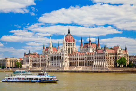 amazing building of Parliament in Budapest and ships in front of it