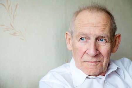 close-up portrait of a pensive senior man, he is looking somewhere Banque d'images