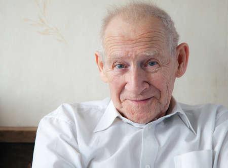 face portrait of a joyful smiling senior man