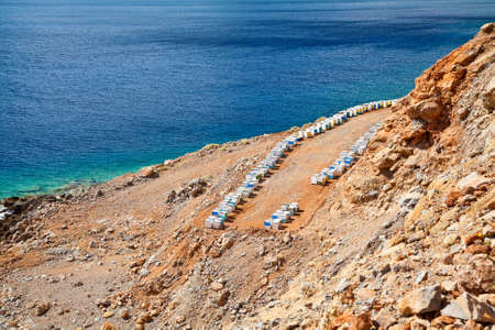 mediterranian houses: beautiful view of beehouses stacking in a row in front of the sea in Crete