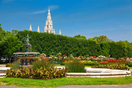 innere: view of Volksgarten - a public park in the Innere Stadt Vienna, Austria. There is a building of the Town Hall behind the trees Stock Photo