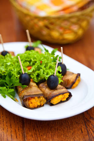 eggplant rolls stuffed with cheese, carrot and garlic photo
