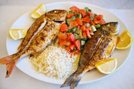grilled gilt-head bream and red snapper served with mixed vegetables, rice and lemon