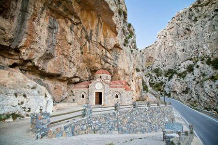 'saint nicholas': greek church of Saint Nicholas the Wonderworker, built under the rock, Crete, Greece Stock Photo