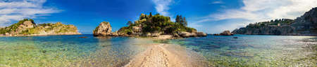taormina: panorama of the beach and island Isola Bella in the city Taormina, Sicily